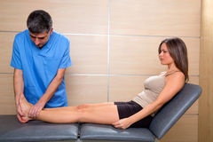 Ankle and Foot examination doctor to woman patient Stock Photo