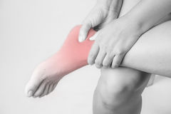 Ankle injury in humans .ankle pain,joint pains people medical, mono tone highlight at ankle.  royalty free stock image