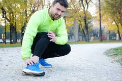Ankle injury and man runner exercising with leg pain Stock Photo