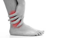 Ankle pain. Young man having pain in his ankle Royalty Free Stock Photos
