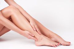 Ankle pain. Female legs. Woman massaging her ankle royalty free stock photo