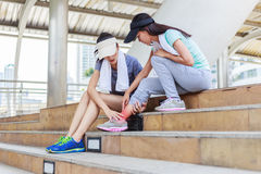 Ankle pain. Sport girl try to help her friend who having symptomatic Stock Photography