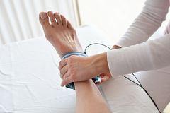 Ankle sprain and electrotherapy. And rehabilitacion Stock Image