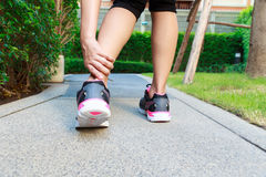Ankle sprain while jogging or running Stock Photo