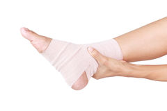 Ankle sprain. Ankle support with elastic bandage stock photo