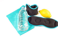 Ankle weights, band, lemon and bottle with water, isolated Royalty Free Stock Photo