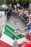 Children celebrate the arrival of the President