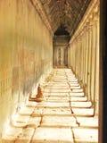 Sunshine and Shadows Corridor Angkor Wat Cambodia. Hall way with sunshine streaming in at Angkor Wat in Cambodia Royalty Free Stock Image