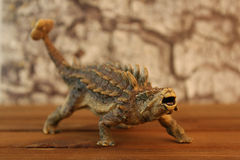Ankylosaurus. Photo of Ankylosaurus dinosaur toy with rock background Royalty Free Stock Image