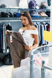 Anl young woman is in the shop Stock Photos