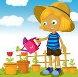 Anlagen einer Mädchenbewässerung Stockfoto