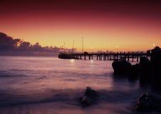 Anlegestelle am Sonnenuntergang Lizenzfreies Stockbild
