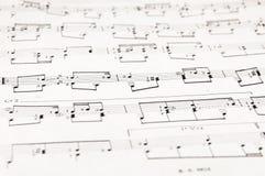 Anmärkningar och musikalnotsystem Royaltyfri Foto