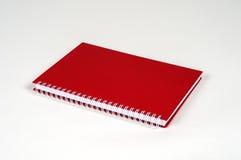 Anmärkningsbok för röd färg Arkivbilder
