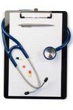 Anmerkungsauflage und Stethoskop Lizenzfreie Stockfotos