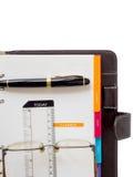 Anmerkungsbuchpapier mit Stift Stockfotografie