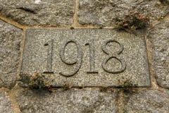 Année 1918 découpée dans la pierre Les années de la Première Guerre Mondiale Photos stock