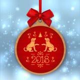 Année de la bannière 2018 de chien Numéro 2018 et chiens d'or sur un fond rouge Étiquette de cadeau de Noël de papier d'emballage Photographie stock