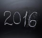Année numéro 2016 écrit sur le conseil Photos stock