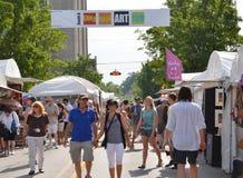Ann Arbor's South University Art Fair 2011. ANN ARBOR, MI - JULY 23: Crowds enjoy Ann Arbor's South University Art Fair 2011.  It is one of four fairs that make Royalty Free Stock Photos