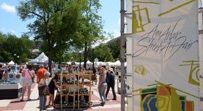 Ann Arbor Street Art Fair. ANN ARBOR, MI - JULY 20: Crowds enjoy the Ann Arbor Street Art Fair in Ann Arbor, MI. It is one of four art fairs in Ann Arbor July 18 Royalty Free Stock Photography
