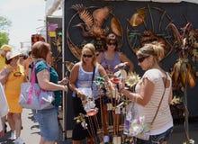 Ann Arbor Summer Art Fair. ANN ARBOR, MI - JULY 20: Visitors admiring Steve and Troy Anderson's sculpture the Ann Arbor Summer Art Fair.  It is one of four art Royalty Free Stock Images