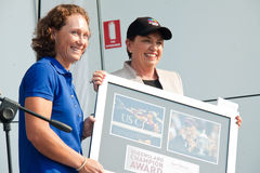 Anna Bligh hand over award to Samantha Stosur. GOLD COAST, AUSTRALIA - SEPTEMBER 19, 2011: Queensland premier Anna Bligh hand over QLD Champion Award to US Open Royalty Free Stock Photography