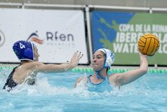 Anna EsparL of CN Sabadell vies with Alejandra AznarR of CN S. Andreu Royalty Free Stock Image
