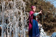 Anna of Frozen fame on float in Disneyland Parade Stock Photo