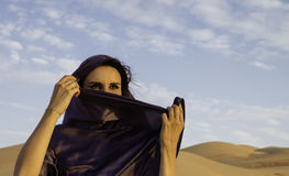 Anna wearing an Abaya in the Empty Quarter. Model Anna wearing an Abaya in the Empty Quarter Desert aka Rub'al Khali, Abu Dhabi, United Arab Emirates Royalty Free Stock Images