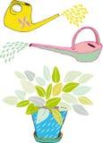 Annaffiatoi e foglie Fotografie Stock