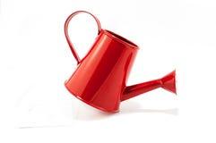 Annaffiatoio rosso isolato su fondo bianco Fotografia Stock Libera da Diritti