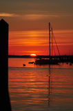 Annapolis Sunrise at City Dock. Bright orange sunrise at City Dock in Annapolis, MD. There is a sailboat and a reflection in the bay stock photography