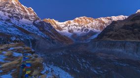 Annapurna base camp in the morning during sunrise. With blue sky royalty free stock photos