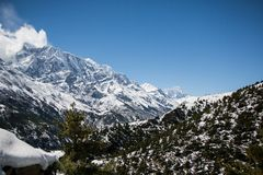 On the Annapurna circuit trekking trail between Upper Pisang village and Ngawal village in the Himalayas in Nepal stock photography