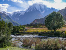 Annapurna 3 in the clouds and Julu village, Nepal Royalty Free Stock Image