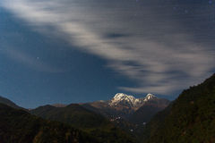 Annapurna I Himalaya Mountains in Nepal at night with clouds mov Stock Images