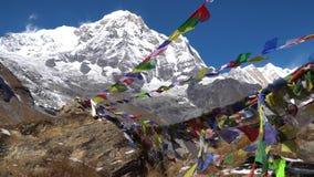 Prayer flags on Annapurna Basecamp, Nepal. Annapurna peak in the Himalaya range, Nepal. Annapurna base camp trek.