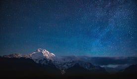 Annapurna I under the stars. View of the Annapurna I under the night sky Himalaya Mountains, Nepal royalty free stock photo