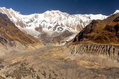 Annapurna 1 and its glacier against blue sky, Himalayas. Annapurna 1 and its glacier against blue sky from Annapurna Base Camp, Himalayas royalty free stock images