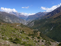 Annapurna and Manang valley from Upper Khangsar, Nepal Stock Photography