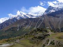 Annapurna and old village Upper Khangsar, Nepal Royalty Free Stock Photo