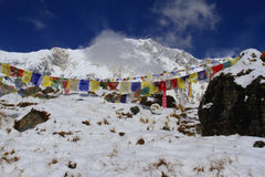Annapurna peak with prayer flags Stock Images