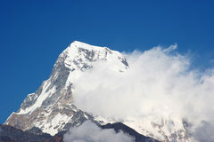 Annapurna 7. Snow-cap Annapurna peak with whirling clouds, nepal Royalty Free Stock Photo
