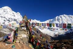 Annapurna 1 and south  on a beautiful bluebird day. Annapurna base camp prey flags nepal Royalty Free Stock Photo