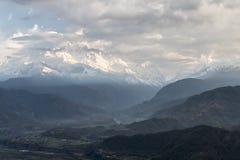 Annapurna south hiding Stock Photos
