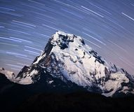 Annapurna South peak - view from Poon Hill on Annapurna Circuit. Panorama of mount Annapurna South, also called Annapurna Dakshin or Moditse, night view. View Royalty Free Stock Photo