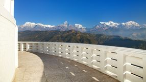 Annapurna view from World Peace pagoda or stupa. Near Pokhara town, Mount Annapurna range, Nepal Himalayas mountains, panoramic view royalty free stock photography