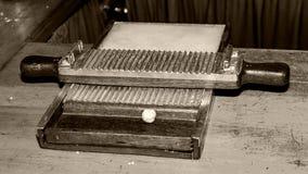 Annata antiquata del creatore della pillola fotografie stock libere da diritti