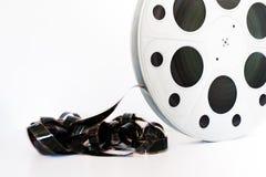 Annata bobina del cinema del film da 35 millimetri su bianco Fotografia Stock